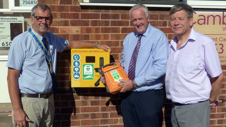 from the left, Pip Rippengill (Rotary Club president) and cyclists Andy Holford and Keith Boyce Pic