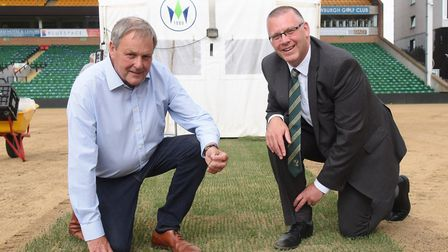 Steve Stone, right, NCFC managing director, with John Hewitt, managing director of Hewitt Sportsturf
