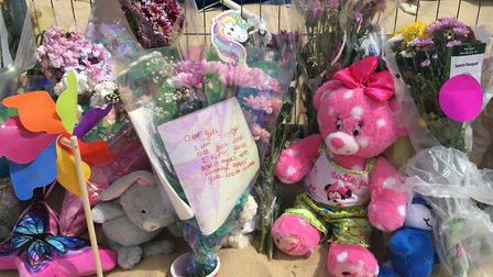 Floral tributes and cuddly toys at the scene where Ava-May Littleboy was thrown from an inflatable t