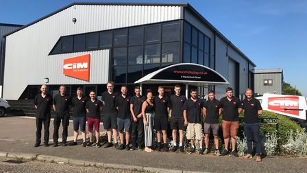 The team at CIM Signs and Graphics, which has expanded premises and doubled its workforce. Pictured
