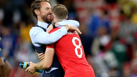 England manager Gareth Southgate celebrates with Jordan Henderson after victory over Colombia Pictur