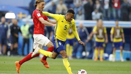 Sweden's Martin Olsson, right, duels for the ball with Switzerland's Michael Lang during the round o