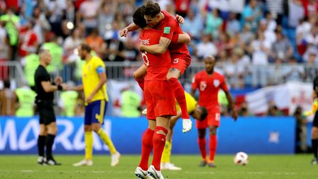 England's Harry Maguire (left) and John Stones celebrate after the final whistle in the World Cup qu