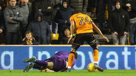 A grounded Christoph Zimmermann gets his head to the ballat Molineux Picture: Paul Chesterton/Focus
