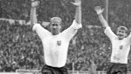 Bobby Charlton and Roger Hunt, right, celebrate England's second goal against Portugal in the 1966 W