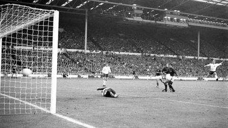 England's Bobby Charlton fires his team's second goal past Portugal goalkeeper Jose Pereira during t