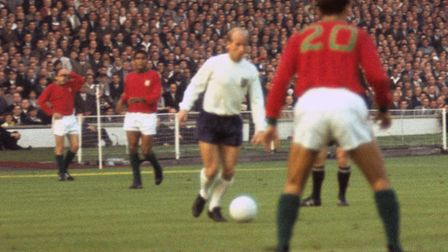 Two-goal hero Bobby Charlton in action for England against Portual at the 1966 World Cup in England