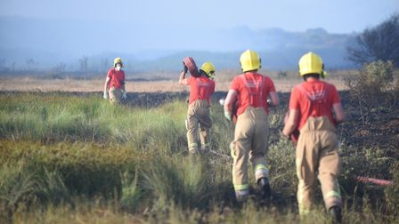 Fire fighters tackle the blaze at Snettisham beach. Picture: Ian Burt