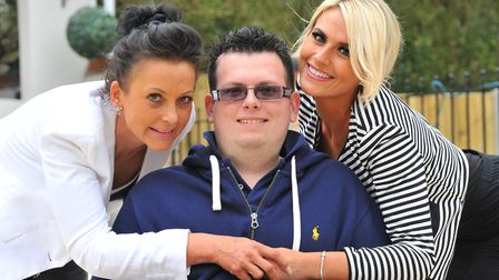 Jack Royall, who suffers from tuberous sclerosis, with mum Ali and sister India. Picture by SIMON FI