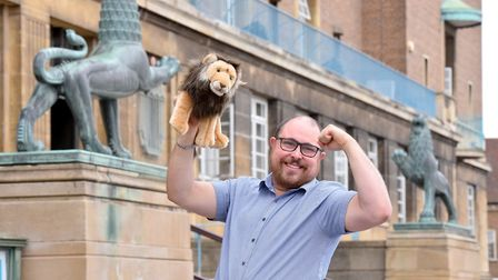 The Norwich Three Lions.. Reporter Dave Hannant by the City Hall Lions. Picture: Nick Butcher