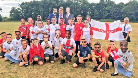 Youngsters at Howard Junior School in King's Lynn celebrating the World Cup, pictured with headteach