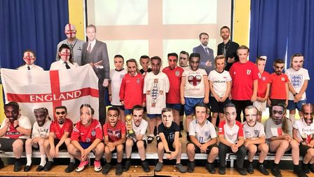 Teachers Rob Parsons and Ashley Kirwan with youngsters from Howard Junior School cheering on England