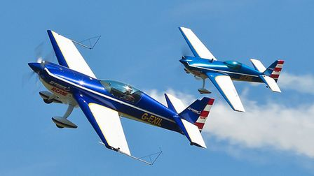 The aerobatic Extra flying in unison with a 'mini me' model is one of the wow moments on the way to