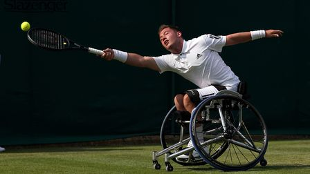 Alfie Hewett at full stretch during the doubles Picture: PA