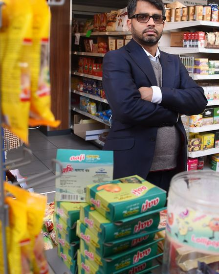 Owner of the Desh Supermarket in Magdalen Street, Abul Hussain, inside the stocked up store which ha