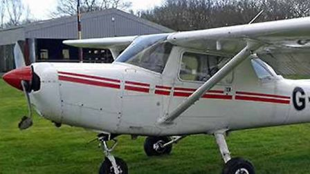 The aircraft with the nose landing gear angles rearwards and the propeller tips bent. Photo courtesy