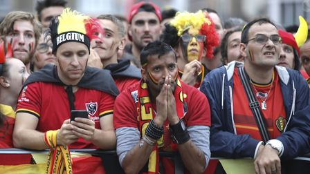 Belgium fans contemplate the consolation prize after defeat to France Picture: PA