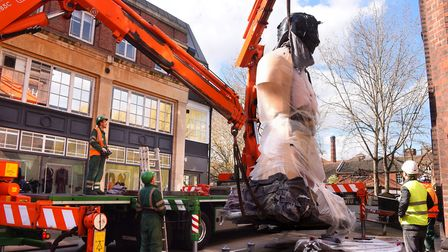 Damien Hirst's statue 'Hymn' is lifted into place during the installation outside NUA. Picture: DENI