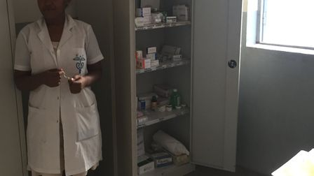 Muriel stands by her medicine cabinet in the pharmacy. Picture: Mark Stubbs