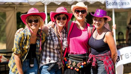 NSFT staff join in the Wild West theme of the summer fete: (from left to right) matrons Charlie Load