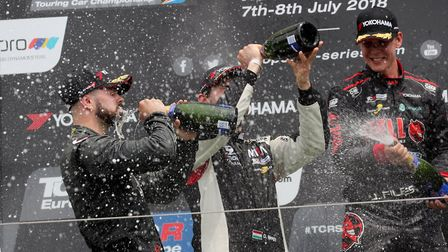 Josh Files celebrating third place in the second TCR Europe race in Hungary. Files is on the right w