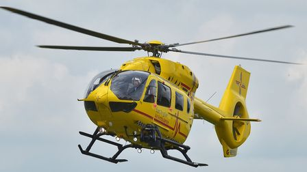 East Anglian Air Ambulance landed at the crash in Pulham St Mary. Photo: Nick Butcher
