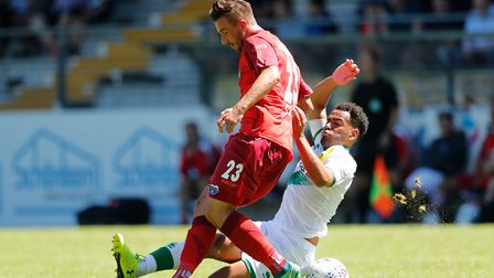 (L-R) Roin Krausse of Paderborn, Louis Thompson of Norwich City during the Friendly match at Bentele