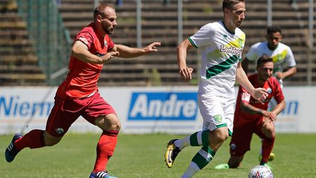 (L-R) Felix Herzenbruch of Paderborn, Marco Stiepermann of Norwich City during the Friendly match at