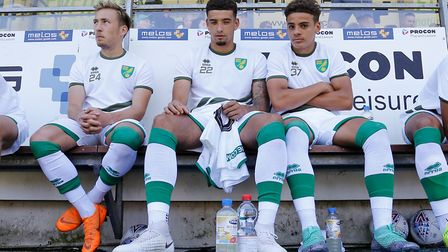 Ben Godfrey (centre) has commited to an extra year at Norwich City - and that will please his Canari