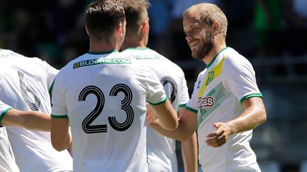 Teemu Pukki, right, celebrates a goal with Kenny McLean Picture: Focus Images Ltd