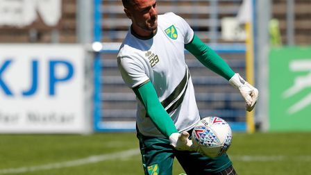 Keeper Remi Matthews warms up - he played the first half against Paderborn Picture: Focus Images Ltd