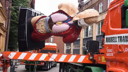The Damien Hirst statue Hymn is put onto the lorry as it is removed from outside the Norwich Univers