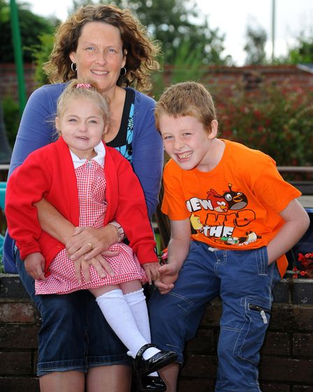 Elois Sharpe from Attleborough who was born with a heart condition at home with mum Sharon and broth