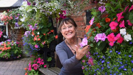 Rita McCluskey, landlady of the Adam and Eve, one of the locations shown to Anglia in Bloom judges d