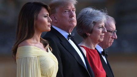 US President Donald Trump and US First Lady Melania Trump stand with Prime Minister Theresa May and