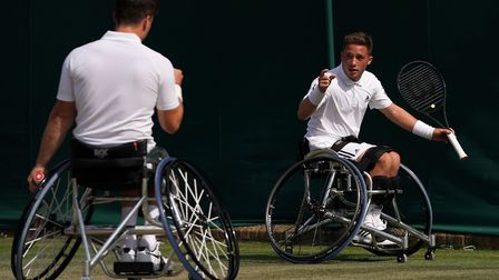 Alfie Hewett, right, and Gordon Reid in action during the doubles at Wimbledon Picture: PA