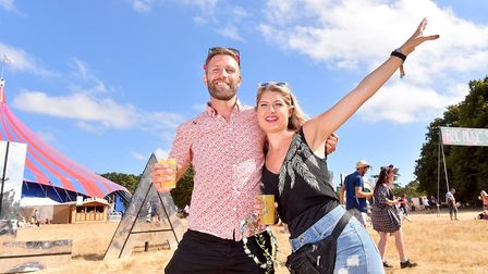 Ben Simpson and Louise Eastwood enjoying the sunshine at Latitude.Picture: Nick Butcher