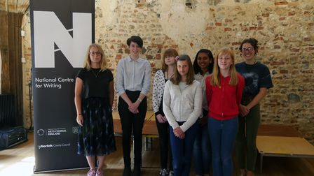 Writer and theatre-maker Molly Naylor with the six winners of the Young Norfolk Writing Competition