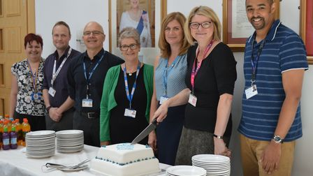 Hilary Winch, lead on Schwartz Rounds cutting the cake with NNUH colleagues. Photo: NNUH