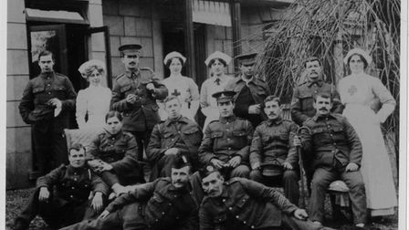 Soldiers and nurses outside Wellingtonia when it was a Red Cross hospital. Picture: North Walsham an