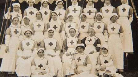Red Cross nurses at a garden party in Town Close, Norwich, August 19, presumed 1917. Cecily Webb, is