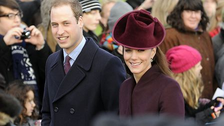 Prince William and the Duchess of Cambridge walk to church at Sandringham. Picture Matthew Usher.