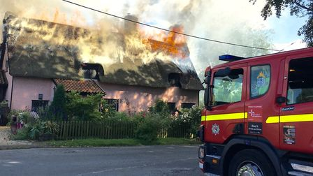 Flames swept across the thatched roof at Yeoman's Cottage in Rockland All Saints. Picture: Karen Ros