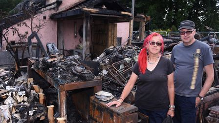 Paul Rutter and Karen Roseberry at their burnt out thatched cottage at Rockland All Saints. Picture: