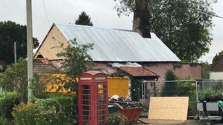 A temporary metal roof has been put on Yeoman's Cottage at Rockland All Saints. Picture: Karen Roseb