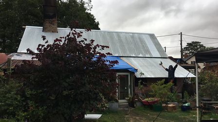 Fitting a temporary metal roof at Yeoman's Cottage in Rockland All Saints. Picture: Karen Roseberry