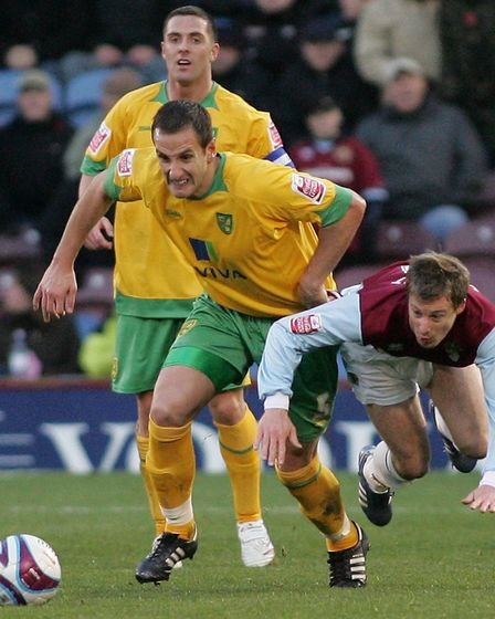 John Kennedy in typically combative action, up against Burnley's Wade Elliott in November, 2008 Pict
