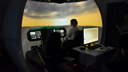 Jenni Armes, client co-ordinator ASP East, at work on one of the simulators at the International Avi