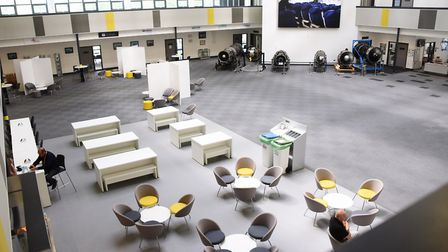 The enormous space with public areas and a café just past reception at the International Aviation Ac
