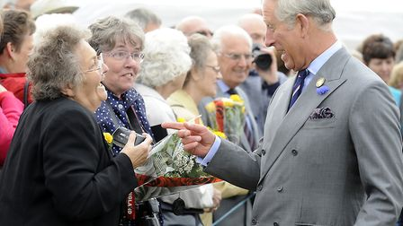 Prince Charles chats to Mary Relph at the Sandringham Flower show 2011 . Picture by: Matthew Usher.